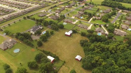 This is a good view of the yards, fields, and woods, thought it doesn't show the entire property.